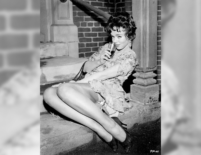 Yvette-Vickers-drinking-on-a-stoop