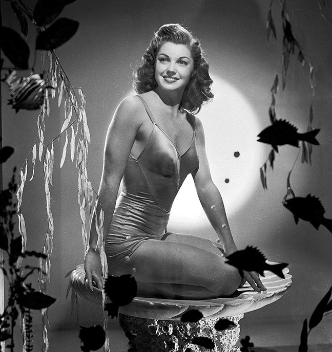 esther-williams-pinup-sitting-in-sea-shell
